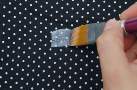 Pintura do tecido com cola da capa