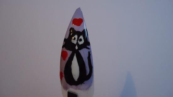 Unha postiça decorada com gatinho