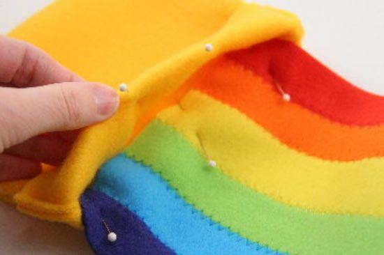 Alfinetando o pote no arco-íris