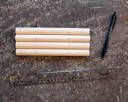 Marcando os cabos de vassoura