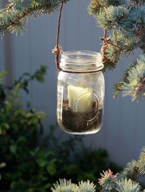 Decoração de jardim com reciclagem de potes de vidro