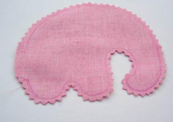 Costura em máquina para o tecido