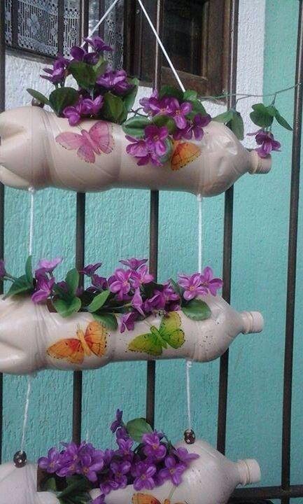 decoração com borboletas em vasos